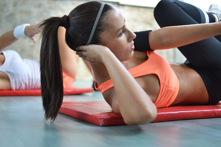 woman-exercising-on-mat.jpg